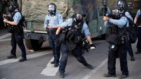 Police toss teargas at demonstrators in Minneapolis on