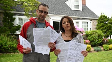 Doug and Marlo Goodstein hold Baldwin absentee ballots