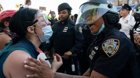 Demonstrators clash with police in Flatbush, Brooklyn, on