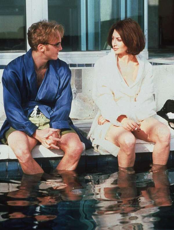 Jay Mohr and Illeana Douglas in a scene