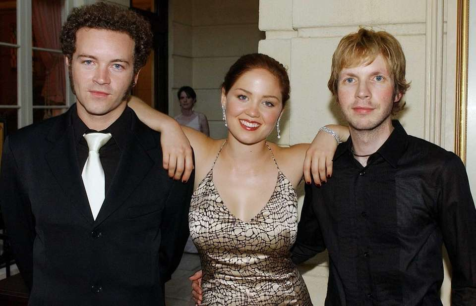 Actors Danny Masterson, left, and Erika Christensen and