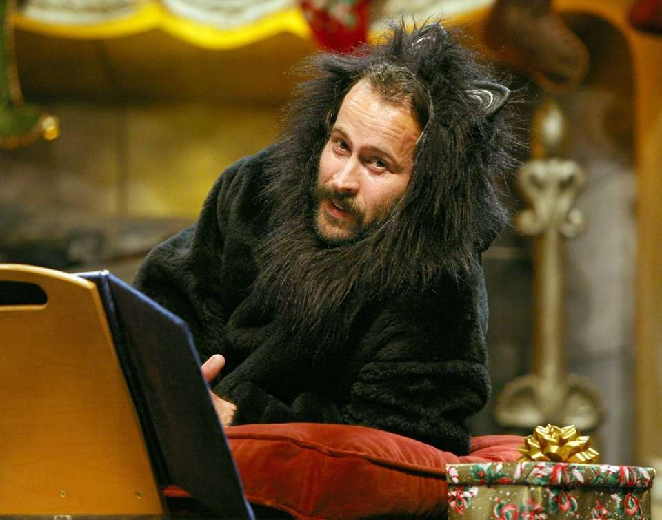 Jason Lee performs as a cat during
