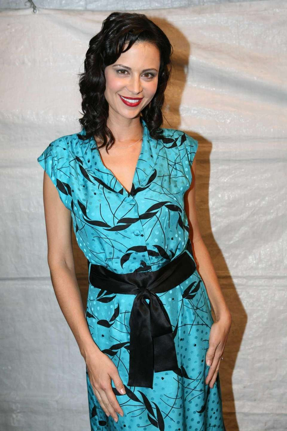 Actress Catherine Bell poses backstage during