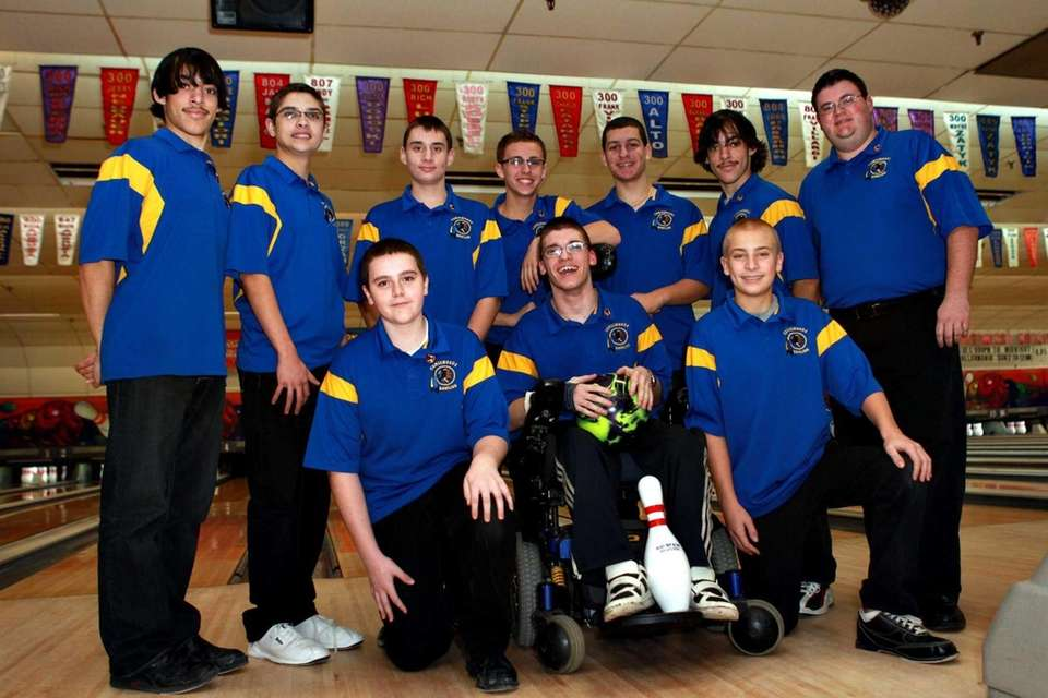 Comsewogue boys bowling teammates surround Mason McFadden before