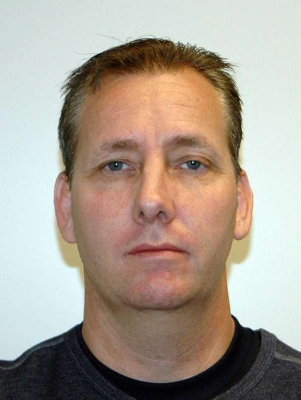 Thomas Schuman, 44, of St. James, was arrested
