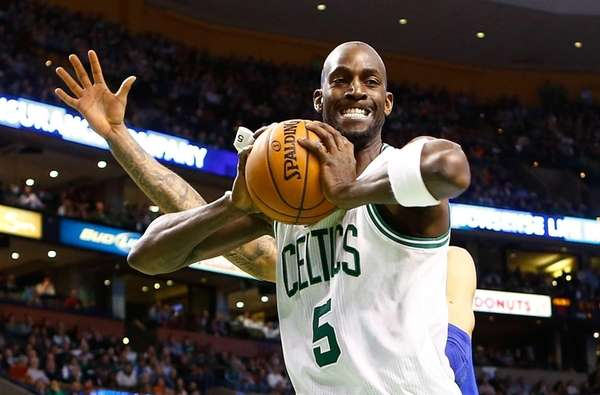 Boston Celtics forward Kevin Garnett grimaces after coming