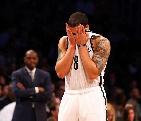 Deron Williams wipes his face during the first