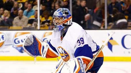 Rick DiPietro stands in goal during a game