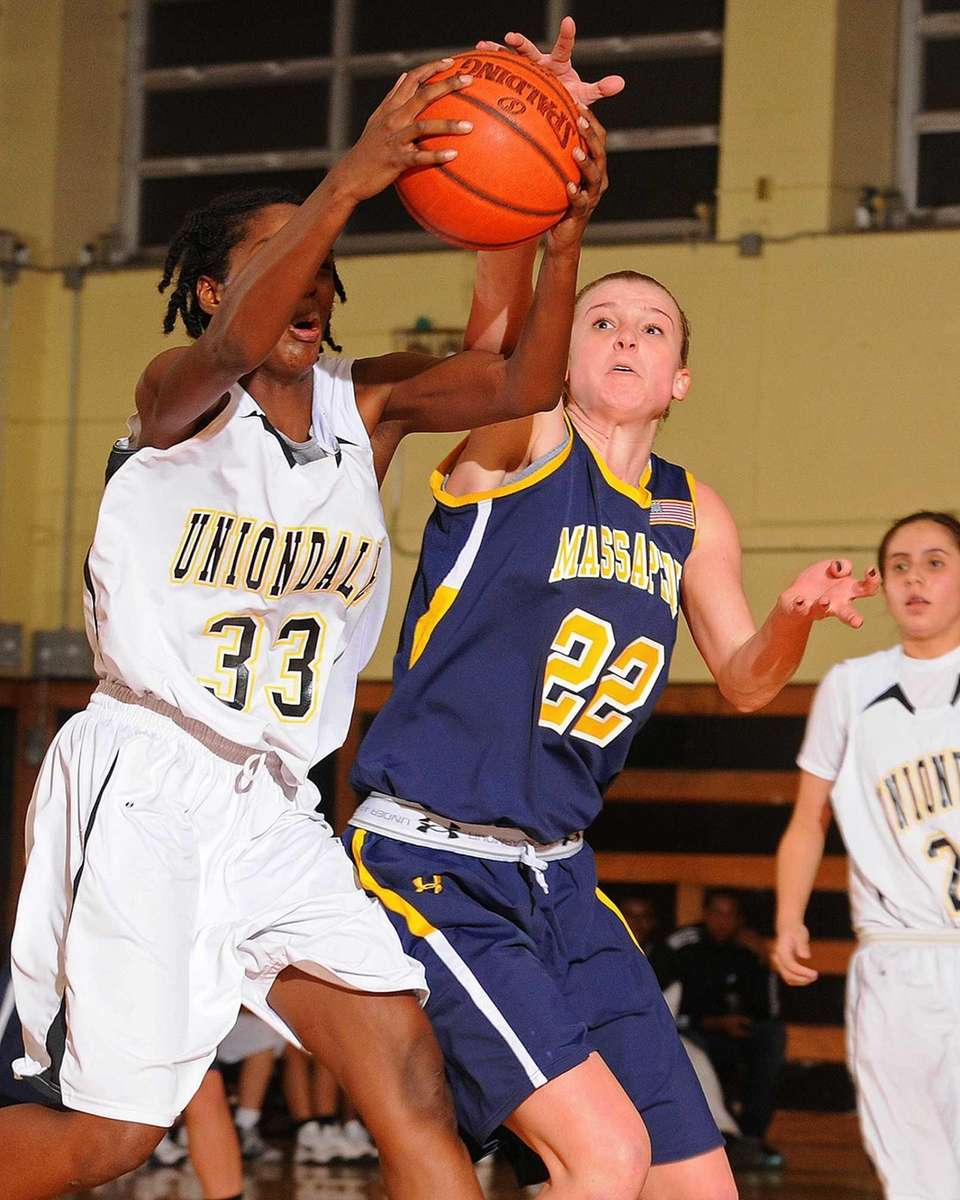 Massapequa senior Lauren Van Buren, right, tries to