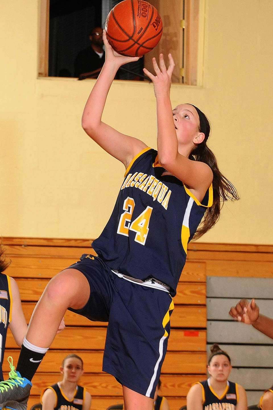 Massapequa's Melanie Hingher drives to the basket in