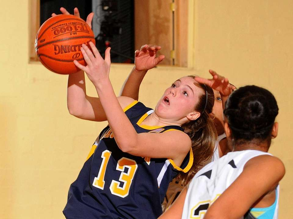 Massapequa's Megan McCabe looks to grab a rebound