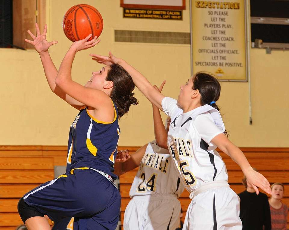 Massapequa's Olivia Batista, left, drives past Uniondale's Ashley