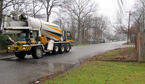 A cement truck heads down Colin Drive, a