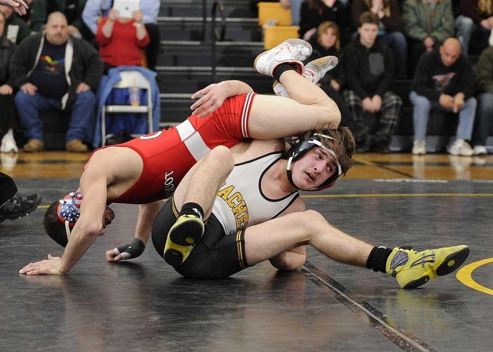 Sachem North's Sean O'Hagan wrestles Connetquot's Gino Titone