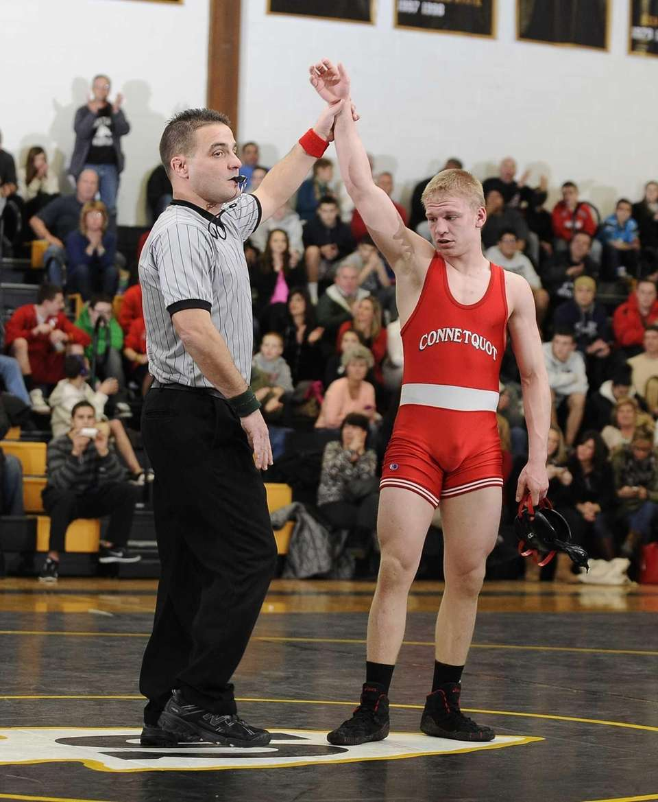 Connetquot's Brendan Dent wins his match against his