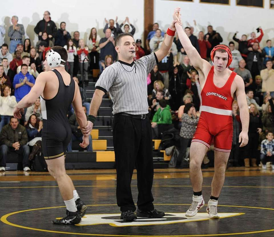 Connetquot's Steve Schmitt wins his match at 152