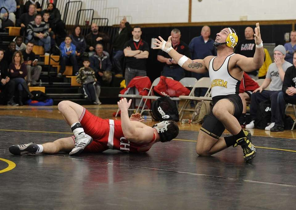 Sachem North's Giovanni Santiago reacts after pinning Connetquot's