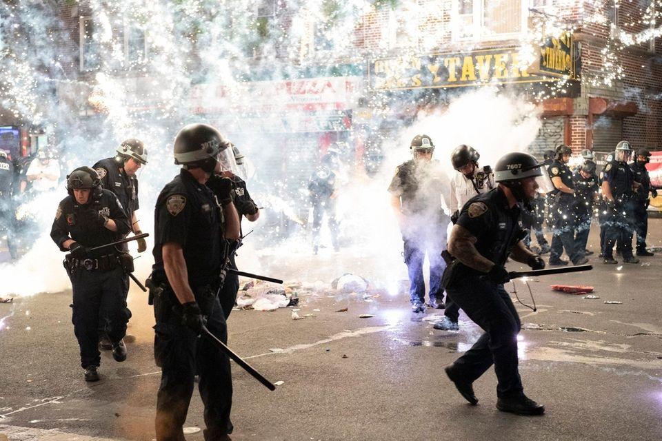 An firework lit by a protester detonates next