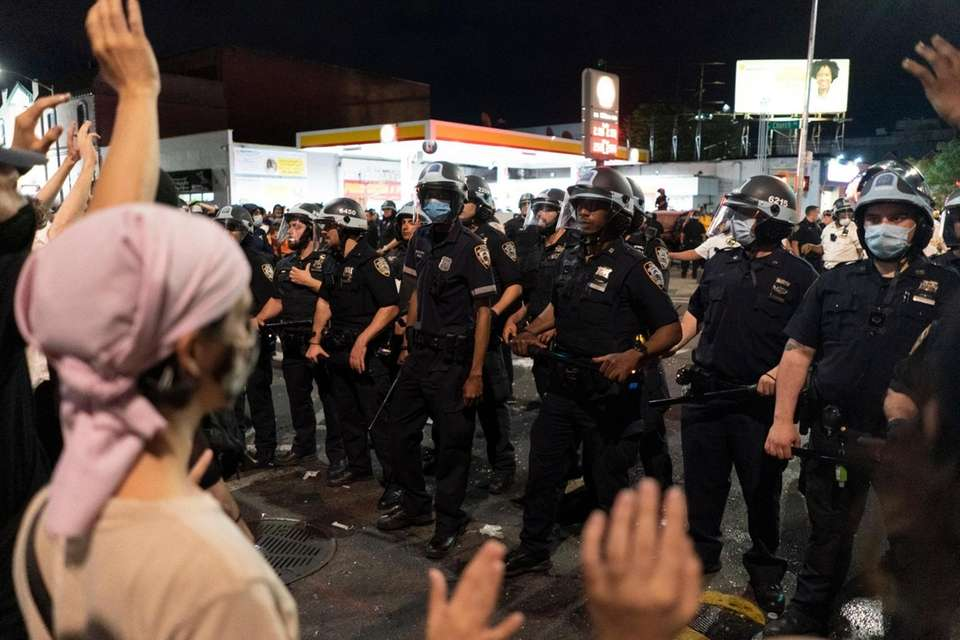 Demonstrators face off with NYPD officers in Flatbush,
