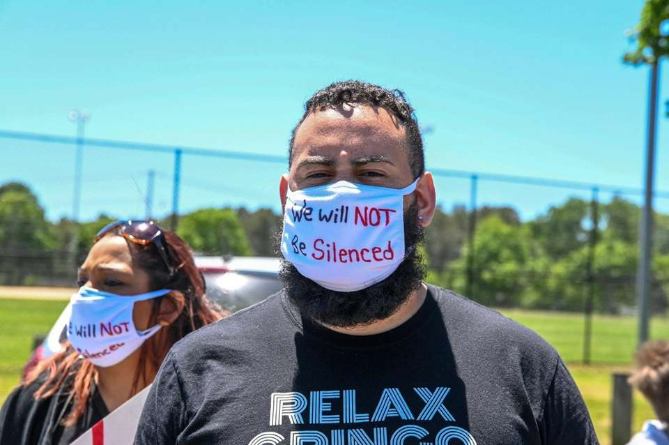 A man attends a rally at Stotzky Park