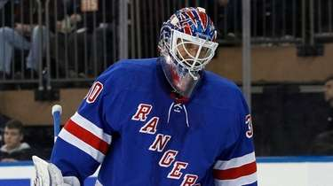 Henrik Lundqvist of the Rangers looks on after