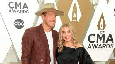 Colton Underwood and Cassie Randolph attend the CMA