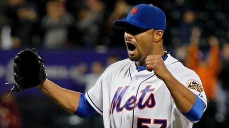 Johan Santana of the Mets celebrates after pitching