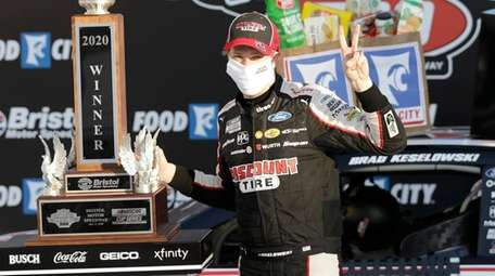 Brad Keselowski celebrates after winning a NASCAR Cup