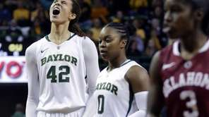 Baylor's Brittney Griner (42) reacts after breaking the