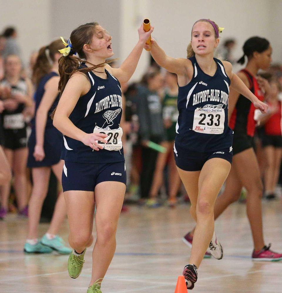 Bayport-Blue Point's Casey Hasher, left, grabs the baton