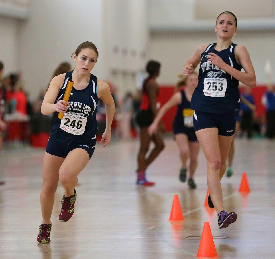 Bayport-Blue Point's Rebecca Muschio, left, gets the baton