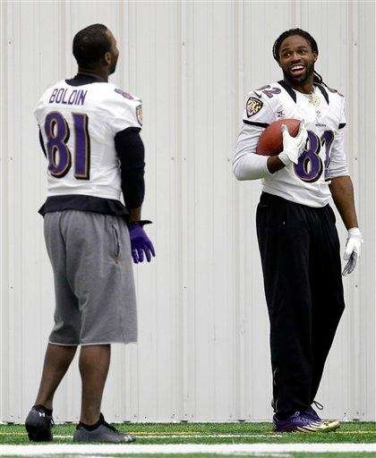 Baltimore Ravens wide receiver Torrey Smith, right, chats