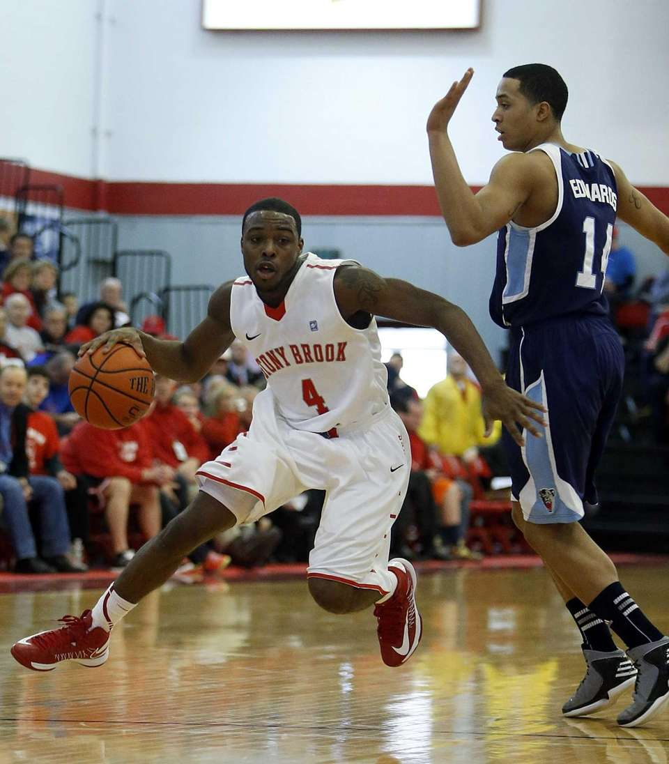 Anthony Jackson of Stony Brook drives against Maine's