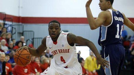 Anthony Jackson of Stony Brook drives against Maine's