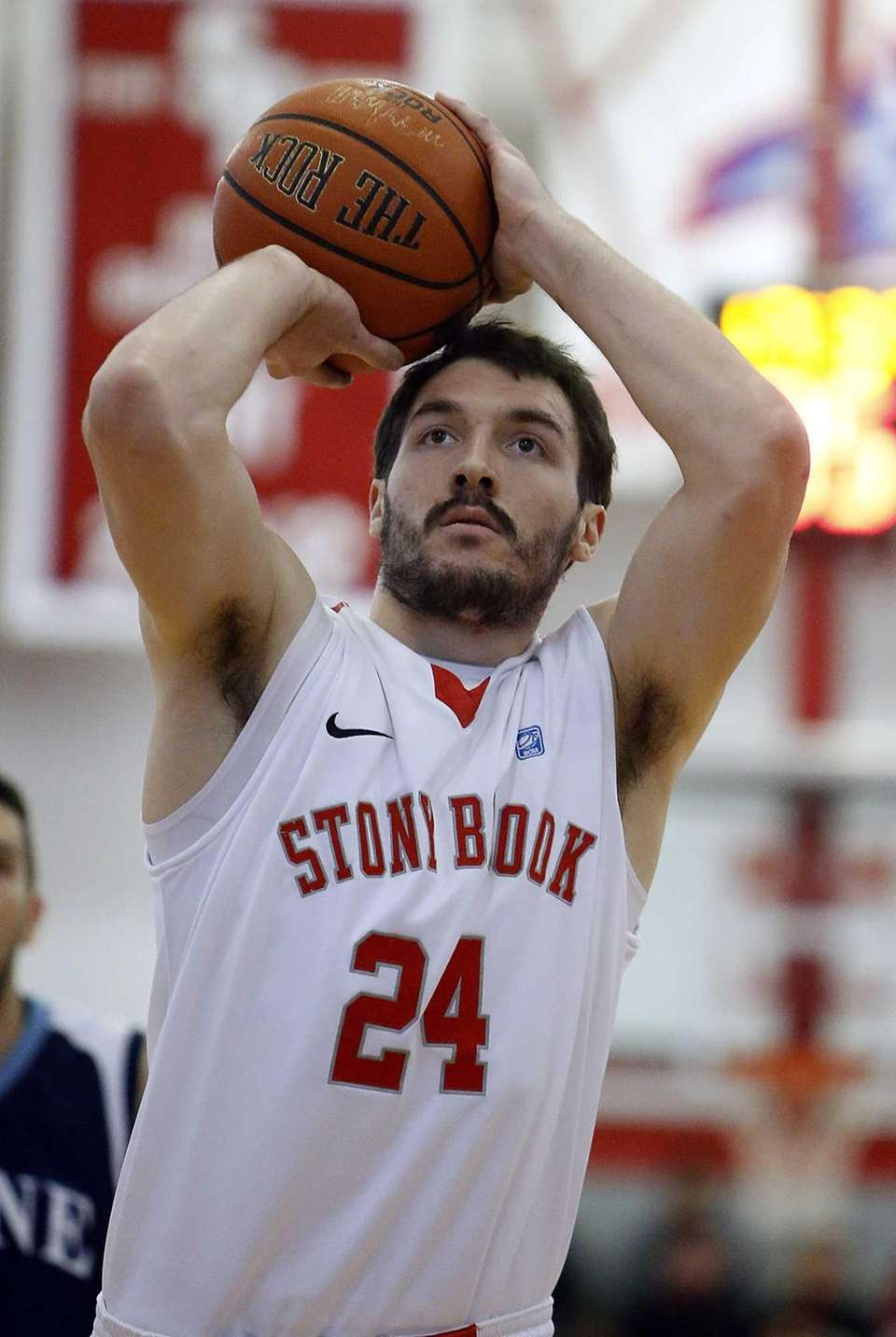 Stony Brook's Tommy Brenton shoots from the foul