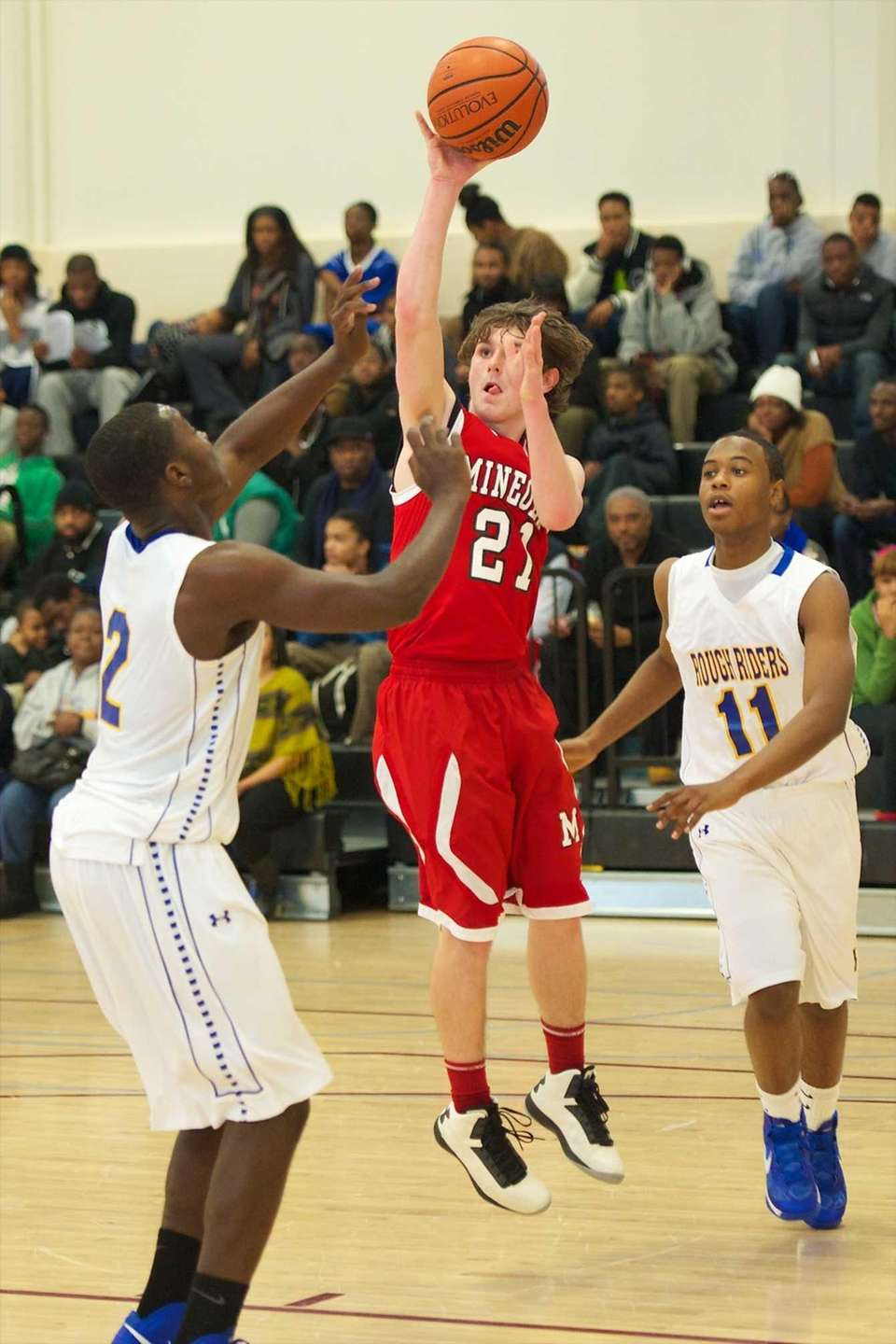 Mineola guard Brian Gaffney takes a jump shot