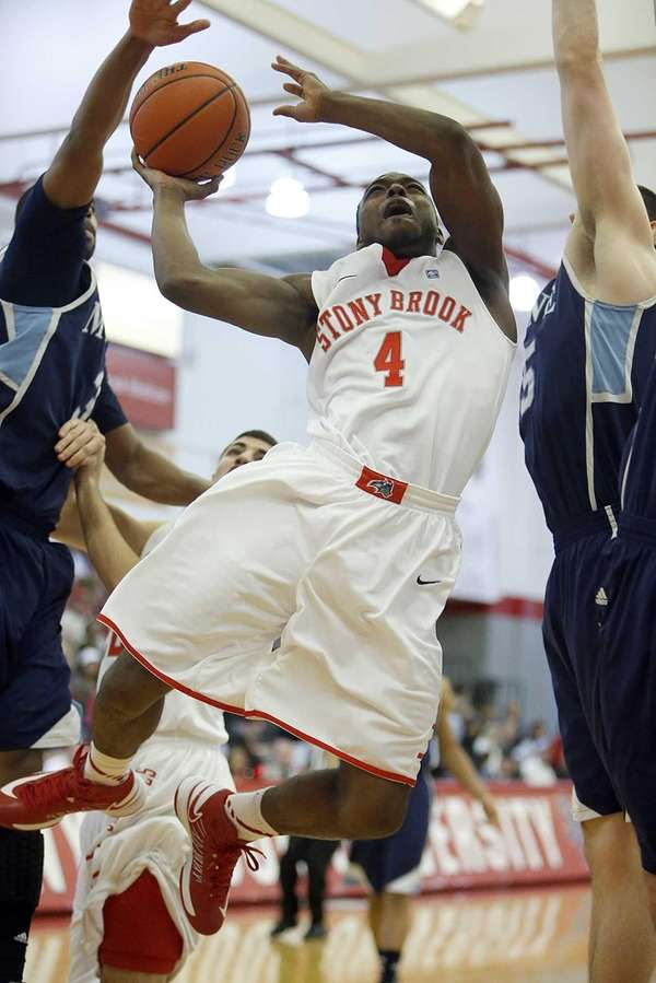 Stony Brook's Anthony Jackson (4) drives to the