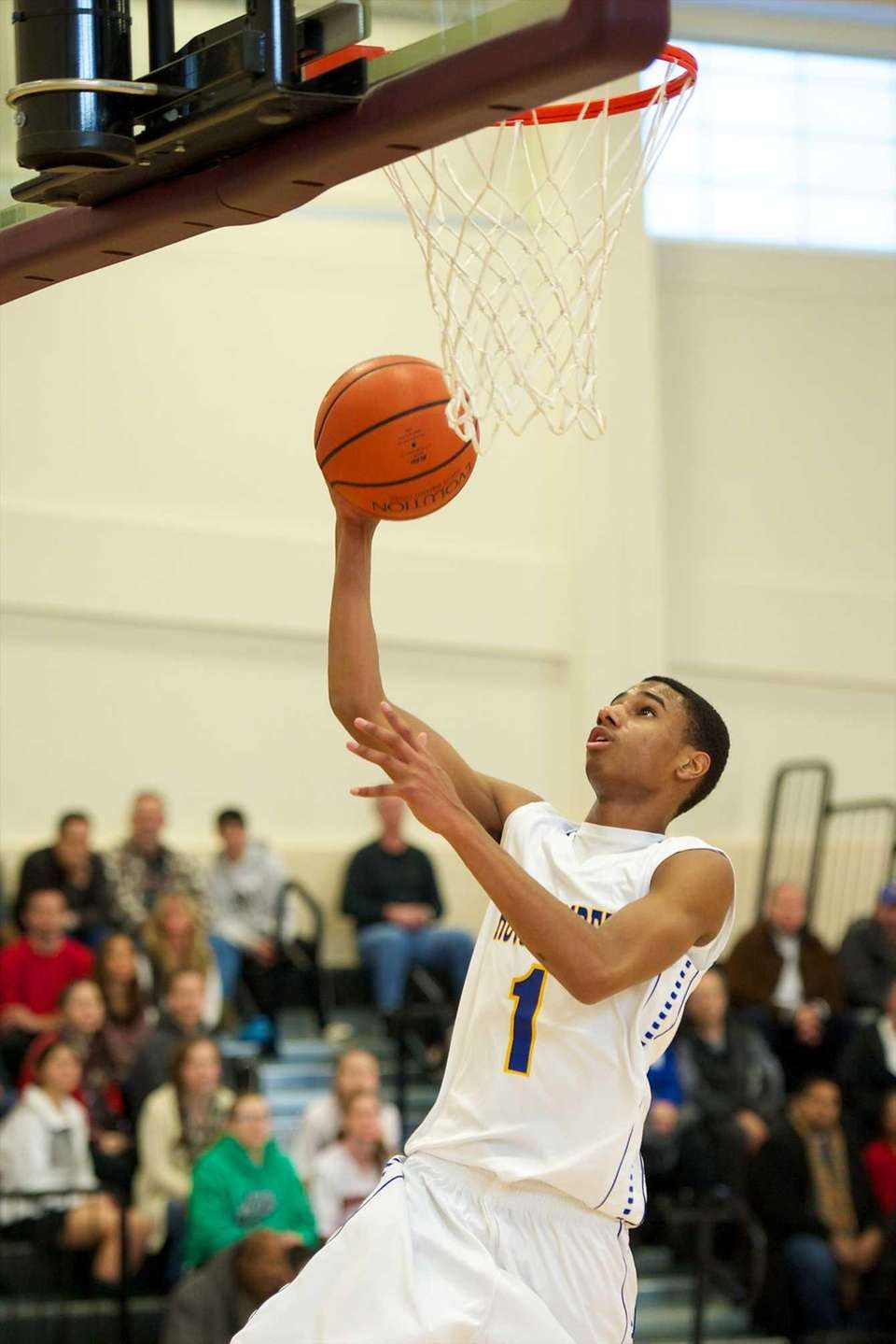 Roosevelt's Jordan Sutton goes for a layup against