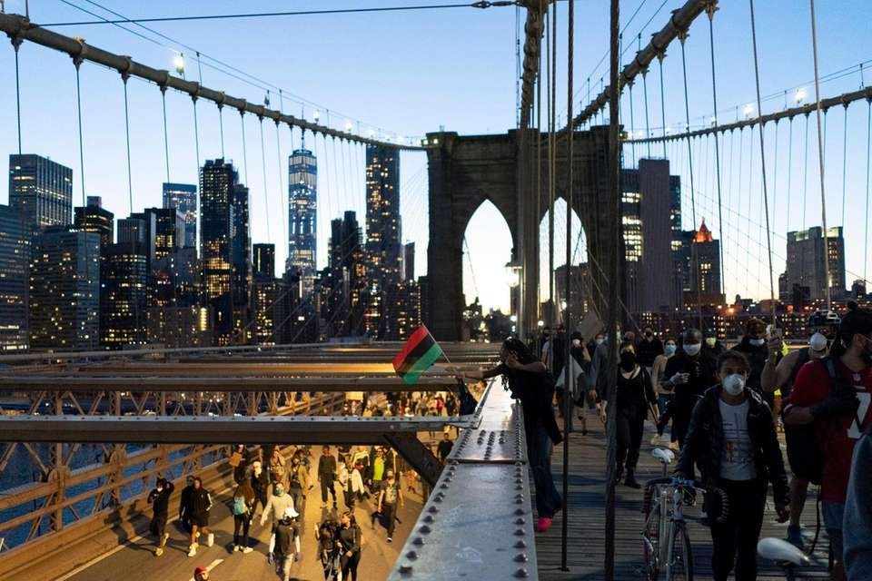 Demonstrators march from Manhattan over the Brooklyn Bridge