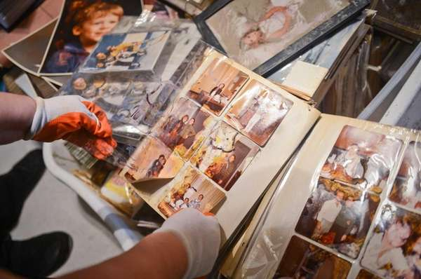Sandy Durando looks through her albums for salvageable