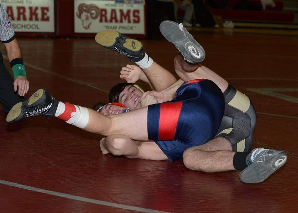 MacArthur's Nick Tangredi (blue/red) is pinned by Wantagh's