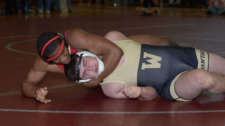 MacArthur's Niem Al-Qaadir (top) works Wantagh's Joe Ulino