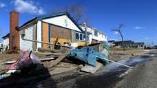 Homes remain boarded up along Bayview Avenue West