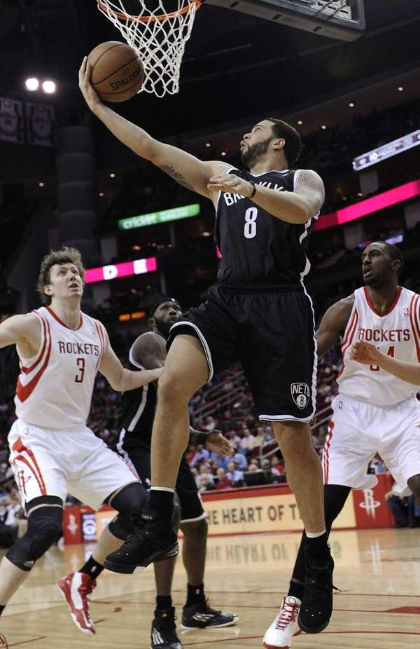 Brooklyn Nets' Deron Williams goes up for a