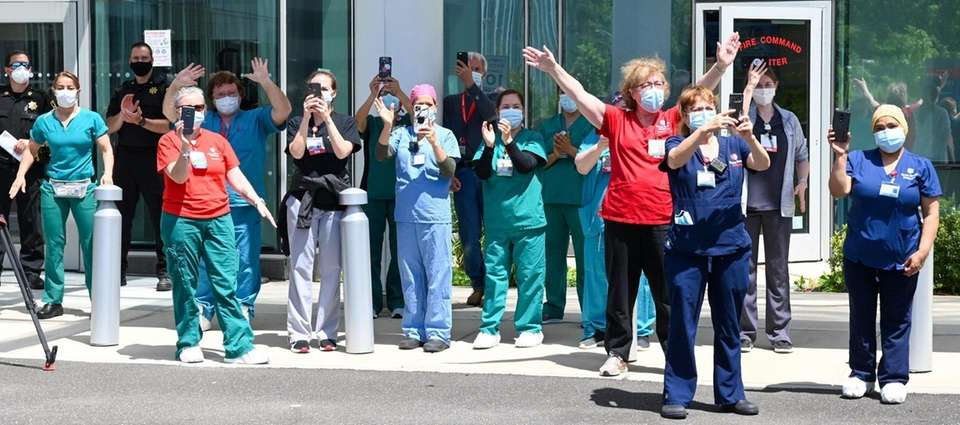 Stony Brook University healthcare staff look on during.