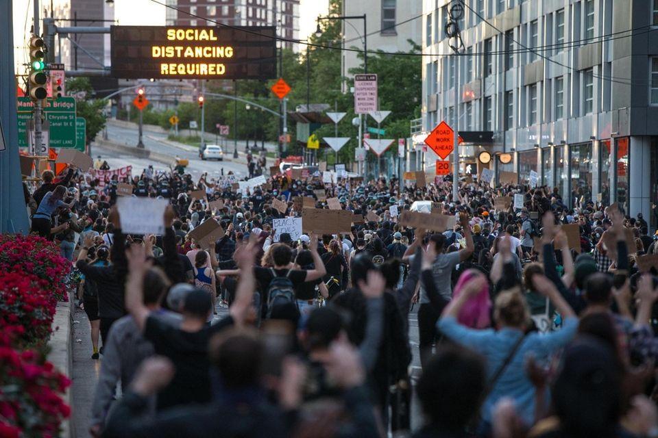 Protestors head towards Brooklyn Bridge in Brooklyn, NY,