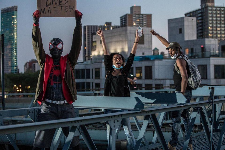 Protestors on Manhattan Bridge during continuing protests stemming