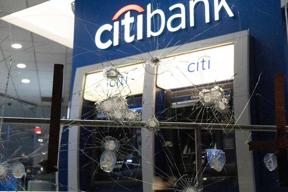 Glass smashed by a hammer at a Citibank