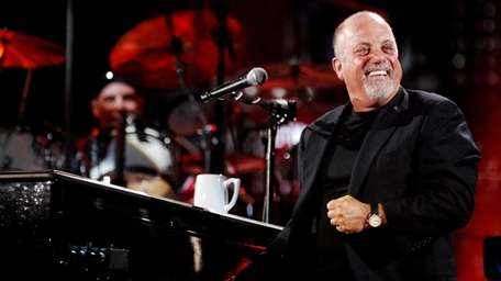 Billy Joel performs at Shea Stadium on July