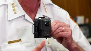 Suffolk County Police Chief Stuart Cameron shows a
